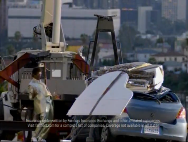 Farmers TV Ad showing piano dropping from crane after car runs into it.