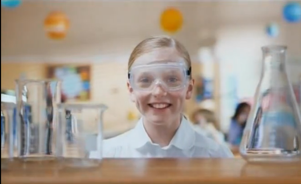 Child in science class wearing safety gear